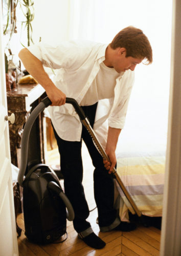 man father doing chores at home