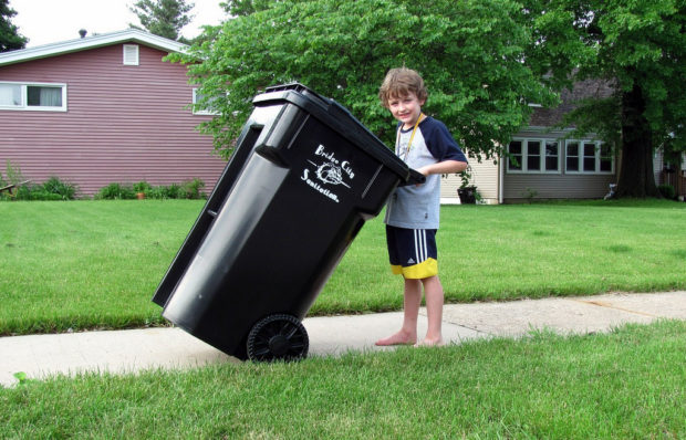 taking out the trash - boy outside
