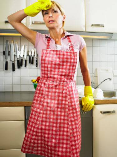 woman tired in kitchen - cleaning washing